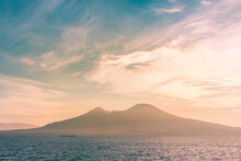 Scenic View Of Sea And Volcano Against Sky