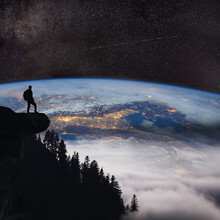 Silhouette Person Standing On Mountain Against Star Field At Night