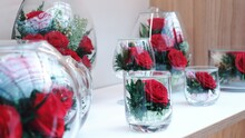 Close-up Of Red Rose In Glass On Table