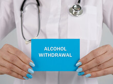 Healthcare Concept Meaning ALCOHOL WITHDRAWAL With Inscription On The Sheet.