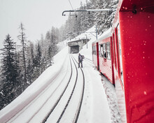 Train On Snow Covered Railroad Tracks During Winter