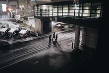 Men Walking Outside Airport Gate On A Winter Night