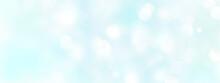 パステルカラーのふんわりした水色のキラキラ背景