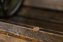 5 Eurocent On A Wooden Bench At A Rainy Day.