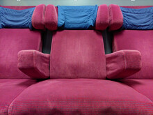 Close-up Of Empty Red Chairs