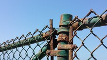 Low Angle View Of Rusty Metal Against Clear Blue Sky