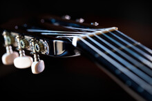 Close-up Of Guitar Against Black Background
