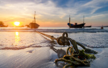 The Anchor Of  Fishery Boats In The Sunset Time.