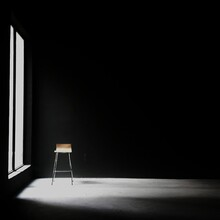Sunlight Falling On Chair By Window