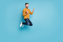 Full Length Body Size View Of Nice Overjoyed Cheerful Guy Jumping Having Fun Rejoicing Isolated On Bright Blue Color Background