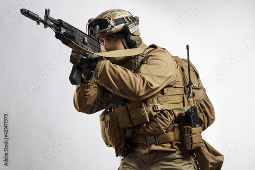 Fotografie, Obraz Male soldier in tactical equipment and uniform (coyote brown color)
