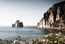 Scenic View Of So Called Pan Di Zucchero Rocks Formation In Sea Against Clear Sky