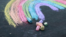 Drawn Rainbow With Sidewalk Chalk On The Ground.
