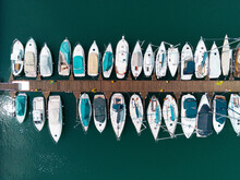Row Of Boats Moored In Calm Blue Water