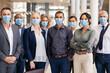Leinwandbild Motiv Portrait of multiethnic business people group wearing mask