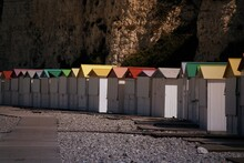 Multi Colored Beach Huts At Shore