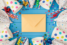 Top View Photo Of Birthday Party Composition Closed Craft Paper Envelope In The Middle Spiral Candles Pipes Striped Straws Hats Confetti Paper Cups And Plates On Isolated Blue Wooden Table Background