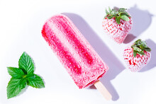 Close-up Of Strawberry Ice Cream Over White Background With Fresh Strawberries
