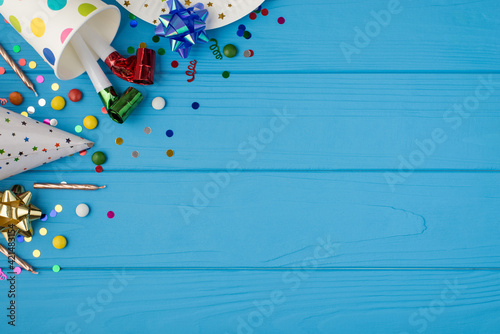 Obraz na plátně Top view photo of birthday party composition in upper left corner ribbon stars c