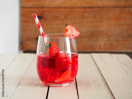 Fototapeta strawberry juice with fresh strawberry in glass for healthy drinking. obraz