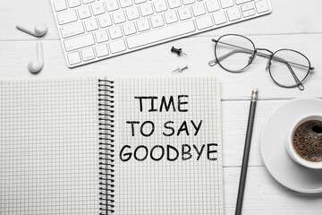 Notebook with text Time to say goodbye on white wooden table, flat lay