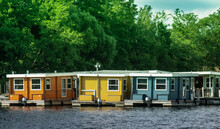 House Boats By River Against Trees