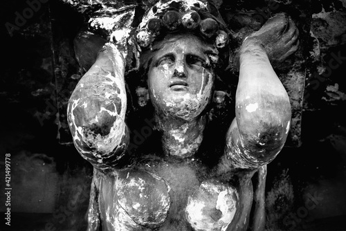 Fotografia, Obraz Dirty ancient stone statue of Olympic goddess of love and beauty in antique myth