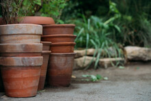 Stack Of Flower Pots In Yard