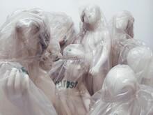 Full Frame Shot Of Wrapped Mannequins