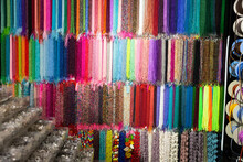 Strands Of Multicolored Beads Offered For Sale On Display In Bijouterie Store..