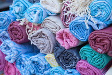 Close-up Of Rolled Up Textile For Sale In Market