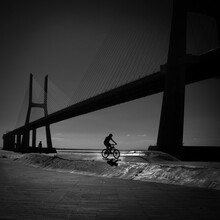 Silhouette Of Person Riding Bicycle On Footpath