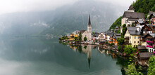 Panoramic View Of Buildings And Lake During Foggy Weather