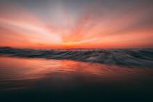 Long Exposure Image Of Sea Against Romantic Sky At Sunset