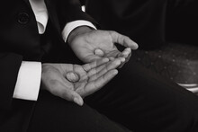 Midsection Of Groom Holding Rings