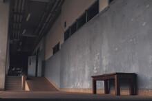 Empty Bench By Building Corridor