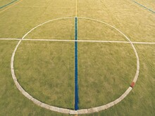Circle In Middle Of Court. Empty Outdoor Handball Playground, Plastic Light Green Surface, Lines.