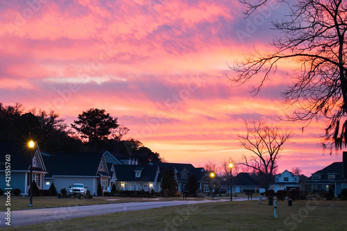 New construction beighborhood at sunset with a purple orange sky.