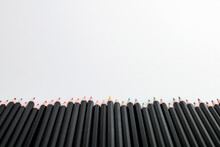 Collection Of Multicolored Pencils On A White Background.