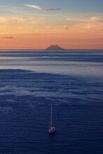 Scenic View Of Stromboli Against Sky During Sunset