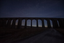 Low Angle View Of Arch Bridge Against Sky At Night