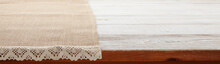 Canvas Napkin With Lace, Tablecloth On Wooden Table On White Background. Can Used For Display Or Montage Your Products. Selective Fokus.