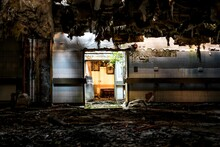 Light Coming Through Doorway In Abandoned Building With Collapsed Ceiling