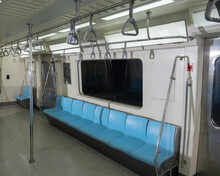 Inside Of A Subway Car And Empty Seat Commuter With Blue Color Interior Inside In The Subway Train..