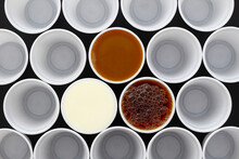 Coffee, Tea And Milk In White Plastic Disposable Cups, View From Above