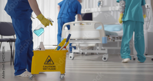 Medical staff doing disinfection and cleaning in intensive care unit of clinic