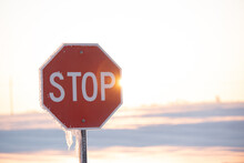 Stop Sign On A Snow And Sunny Day