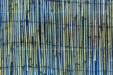 Bamboo Mat Texture Against A Black And Blue Background