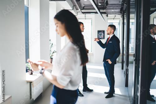 Fotografie, Obraz Group of coworkers standing in corridor of modern office