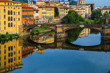 Reflection Of The Bridge In The River Arno In Florence